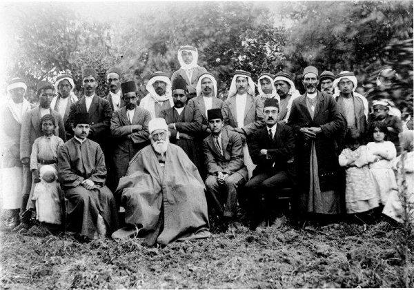 FRONT ROW (L to R): Sobhi ('Abdu'l-Baha's faithful secretary), 'Abdu'l-Baha, Jalal Azal, Azizullah Bahadur.