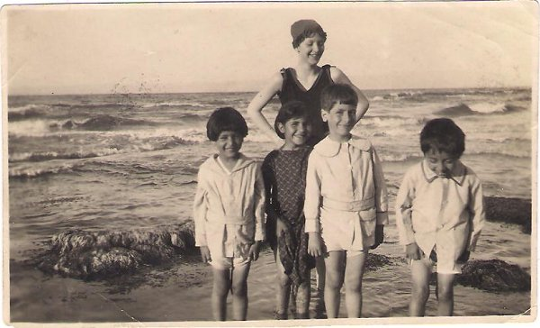 Mary Maxwell (standing at the back). Left to Right: Riaz Rabbani, Nouriyeh (daughter of 'Abdu'l-Baha's housekeeper), Hassan Jalal Shahid, Fuad Afnan.