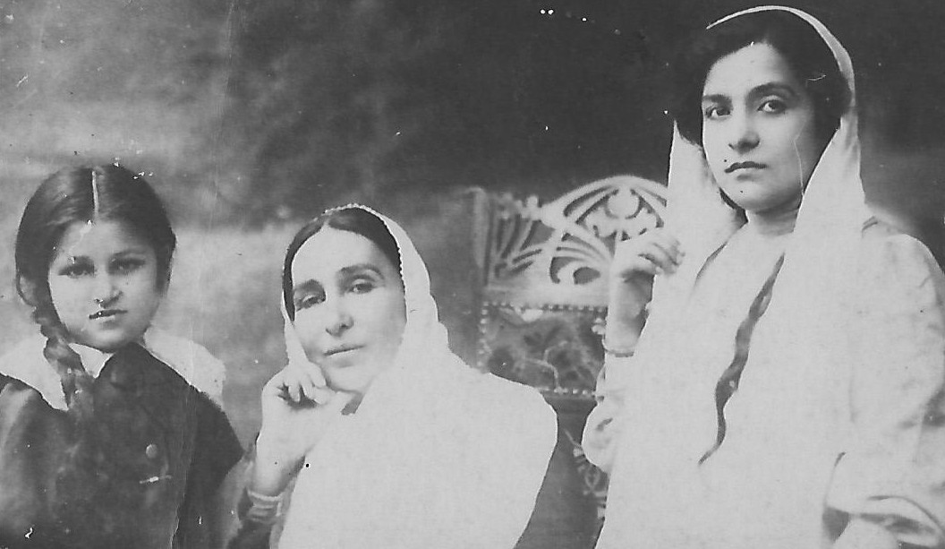 Seated centre, Munireh Khanum, wife of Abdul Baha with her daughter Zia Khanum and her grand daughter Ruhanguise