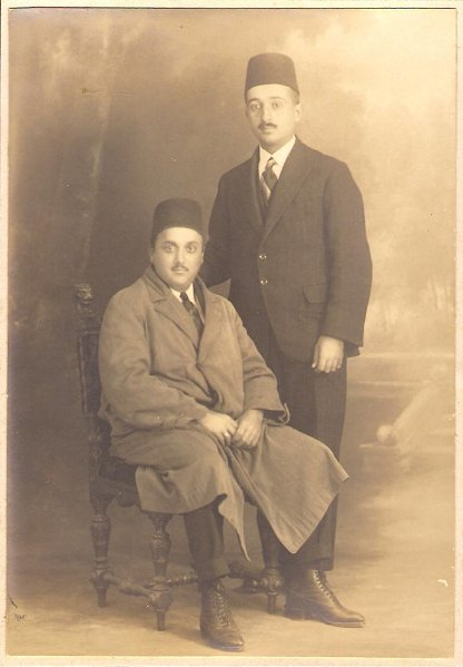 Shoghi Effendi (sitting) and Ruhi Afnan (standing).